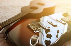 Abrégé sur macro d'ukulélé et de guitare électrique Images libres de droits