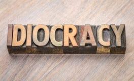 Abrégé sur mot d'Idiocracy dans le type en bois Photo libre de droits