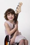 Abraçando a guitarra-baixo Imagem de Stock Royalty Free