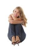 Abraçando joelhos Foto de Stock Royalty Free