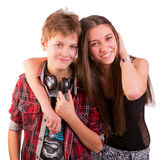 Abraço bonito feliz de dois adolescentes Imagem de Stock