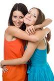 Abraço e sorriso da mulher dois nova imagem de stock royalty free