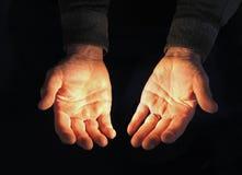 Abra as mãos, iluminadas Fotos de Stock