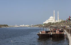 Abra boat overlooking the Khalid Lagoon and Al Noor Mosque (Al Noor Mosque). Sharjah. United Arab Emirates Royalty Free Stock Images