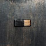 Abra a caixa de fósforos preta Imagens de Stock Royalty Free