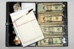 Abra a caixa do dinheiro no branco Imagens de Stock Royalty Free