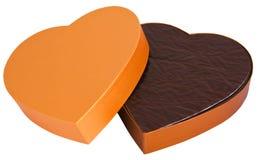 Abra a caixa dourada dada forma coração do chocolate isolada Imagem de Stock