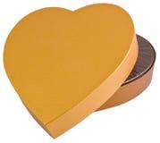 Abra a caixa dourada dada forma coração do chocolate isolada Foto de Stock Royalty Free