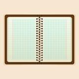 Abra el cuaderno con la página blanca en fondo beige Fotografía de archivo