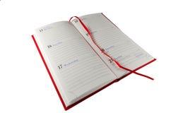 Abra el cuaderno en blanco y la cubierta roja fotos de archivo