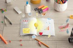 Abra el cuaderno en el piso con los instrumentos próximos Imagen de archivo