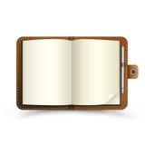 Abra el cuaderno marrón Imagen de archivo libre de regalías