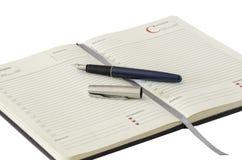 Abra el cuaderno y la pluma Imagen de archivo libre de regalías