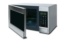 Abra el horno de microondas aislado en un fondo blanco Imagen de archivo