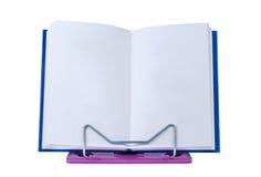 Abra el libro con las paginaciones en blanco en soporte. fotos de archivo