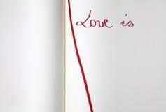 Abra el libro de ejercicio en blanco (el amor es) Imagen de archivo libre de regalías