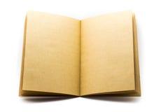 Abra el libro de papel marrón aislado en el fondo blanco Imágenes de archivo libres de regalías