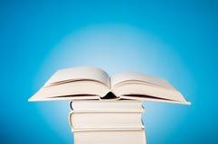 Abra el libro en azul Imagen de archivo libre de regalías