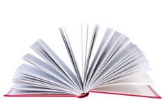 Abra el libro en el fondo blanco. Fotos de archivo