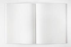 Abra el libro en el fondo blanco Fotografía de archivo