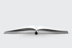 Abra el libro en el fondo blanco Imagen de archivo libre de regalías