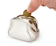 Abra el monedero blanco con la mano foto de archivo libre de regalías
