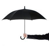 Abra el paraguas en mano humana Fotos de archivo
