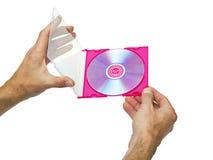 Abra el rectángulo con un DVD en las manos del varón fotos de archivo libres de regalías