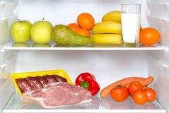 Abra el refrigerador por completo de frutas Foto de archivo libre de regalías