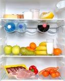 Abra el refrigerador por completo de frutas y de la carne Imagen de archivo libre de regalías