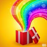 Abra el regalo con el arco iris Imagenes de archivo