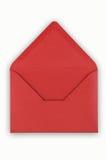 Abra el sobre rojo en el fondo blanco. Fotografía de archivo