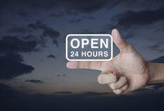 Abra 24 horas de ícone no dedo Imagens de Stock Royalty Free