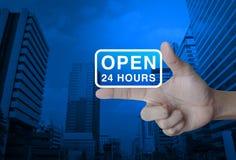 Abra 24 horas de icono en el finger Foto de archivo libre de regalías
