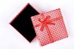 Abra la caja de regalo roja, visión superior Imagen de archivo