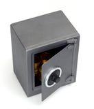 Abra la caja fuerte con las monedas fotografía de archivo