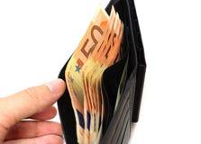 Abra la cartera por completo de efectivo euro Foto de archivo libre de regalías