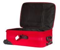 Abra la maleta roja con la etiqueta de identificación en blanco Fotografía de archivo
