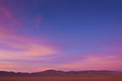 Abra largamente o por do sol do deserto fotografia de stock royalty free