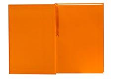 Abra o caderno alaranjado isolado Fotografia de Stock