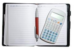 Abra o caderno com pena e calculadora Fotos de Stock Royalty Free