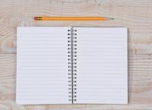 Abra o caderno e o lápis Imagens de Stock