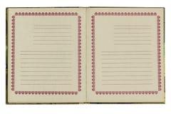 Abra o caderno velho, isolado no fundo branco Foto de Stock