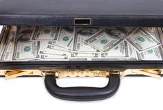 Abra o caso com dinheiro Fotografia de Stock Royalty Free