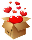 Abra o presente com corações do voo no fundo branco Foto de Stock