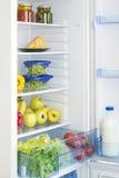 Abra o refrigerador completamente de frutas e legumes frescas Fotos de Stock Royalty Free