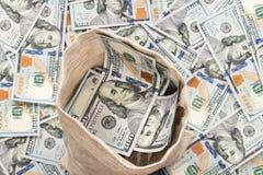 Abra o saco completamente de dólares do dinheiro Foto de Stock Royalty Free