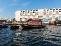 Abra water taxis for transport across the Creek in Dubai. Wooden boats called abra water taxis for public transport across the Creek from Deira to Bur Dubai in Royalty Free Stock Image