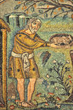 Abraham and God. Abraham offers a gift to three mysterious strangers, who predict that he will be a father again. Scene from UNESCO listed byzantine mosaics in royalty free stock photography