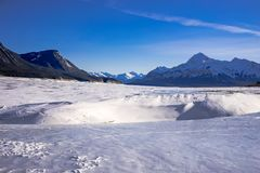 Abraham lake in snow with blue sky Stock Images